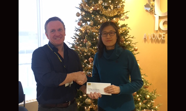 Pictured here with Union Rep David, Sophie's mom Jing Zhou accepts her daughter's scholarship winnings