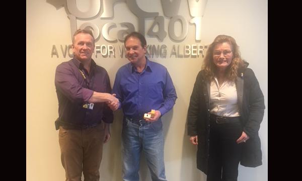 Karl (centre) with Union Rep David and Secretary Treasurer Theresa