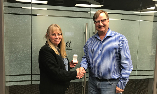 Margaret receives her retirement ring from Union Rep Larry