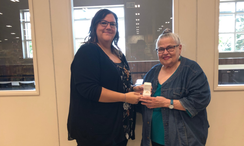 Kay Gusso (R) is presented with retirement ring by Union Rep Char