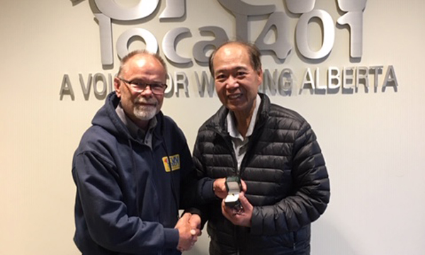Ken (pictured on right) receives his retirement ring from his union rep John