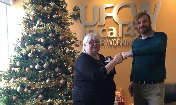 Marian Ehry is pictured here being presented with her UFCW 401 retirement ring by her union rep Jeff