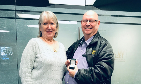 Long-time member Perri Garvin (right) receives his 401 retirement ring from UFCW admin Arlene