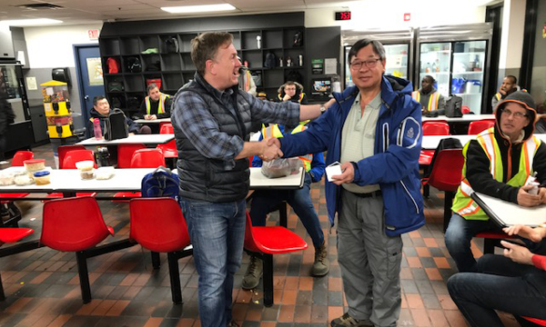 Vance receives his 401 retirement ring from his Union Rep David