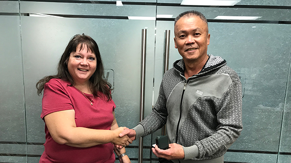 Vincent Tang is presented with his 401 retirement ring by his Union Rep Cheryl