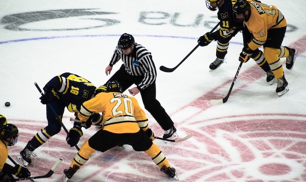 Face-off in hockey game (https://unsplash.com/@naive_eye)
