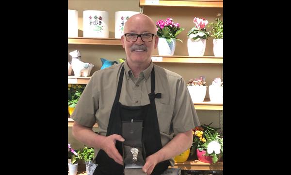 Dean receives his UFCW 401 retirement watch from Shop Steward Judy