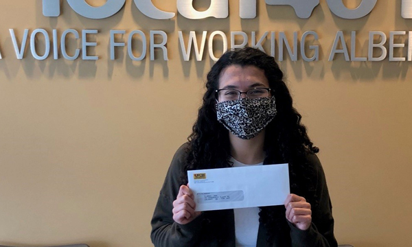 Ana picks up her scholarship cheque at the union office