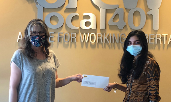 Areej receives her cheque from UFCW 401 admin Tammy